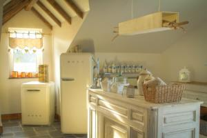 A kitchen or kitchenette at Thermes des Sources