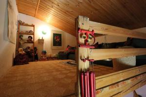 A bunk bed or bunk beds in a room at Mirage Apartment