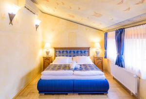 Cama o camas de una habitación en Hotel Elite Prague