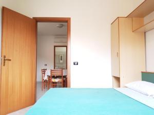 Een bed of bedden in een kamer bij Villaggio Camping Lungomare