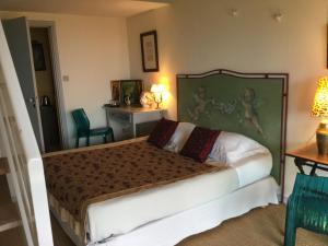 Un ou plusieurs lits dans un hébergement de l'établissement La Maison de Manon