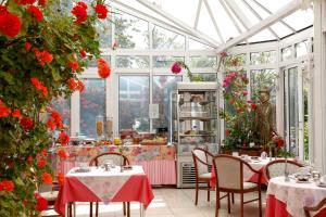 Restaurant ou autre lieu de restauration dans l'établissement Hôtel L'Ecrin