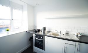 A kitchen or kitchenette at Fox Street Studios