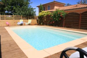 The swimming pool at or near Maison Addama