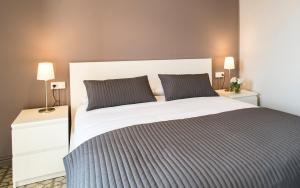 Cama o camas de una habitación en Barcelonaguest