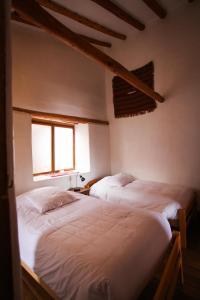 Cama o camas de una habitación en El Balcón