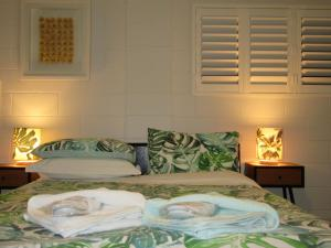A bed or beds in a room at Greenfields