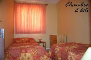 A bed or beds in a room at Appartement La Marmotte