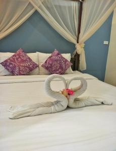 A bed or beds in a room at Blue House Sukhothai