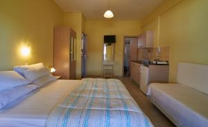 A bed or beds in a room at Sarti Paradise