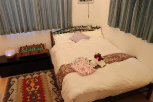 A bed or beds in a room at Tokyo Nippori Japanese-Style Villa