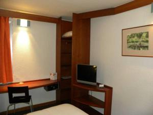 A television and/or entertainment center at ibis Douala