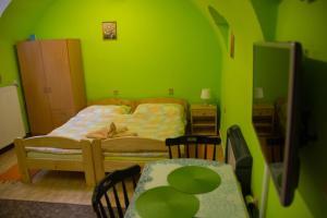 Postel nebo postele na pokoji v ubytování Penzion H-Market
