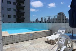 The swimming pool at or near Apartamento Alice Tenório