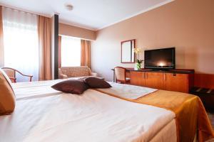 Letto o letti in una camera di Hotel Vivat