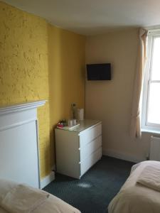 A television and/or entertainment center at Sailors Return Weymouth
