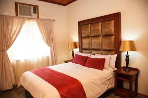 A bed or beds in a room at Blyde Canyon, A Forever Resort