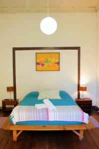 Cama o camas de una habitación en Casa Volante Hostal