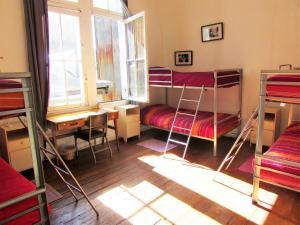 Litera o literas de una habitación en Casa Volante Hostal