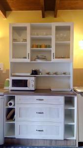 Kuchyň nebo kuchyňský kout v ubytování Apartments Tatiana