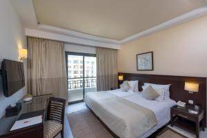 ル コライユ スイーツ ホテルにあるベッド