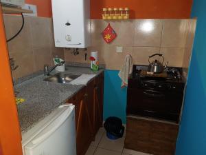 Una cocina o kitchenette en Cabañas Alma