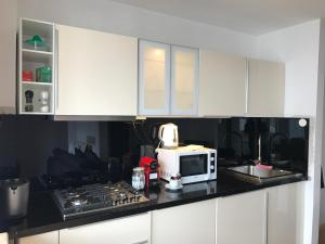 A kitchen or kitchenette at Lux Apartments