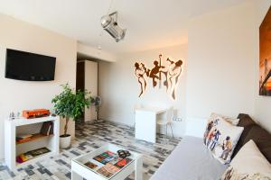 A television and/or entertainment center at Jazzy Sofia Downtown Apartment