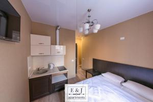 A bed or beds in a room at Apartment E&J