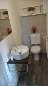Ein Badezimmer in der Unterkunft Ferienbungalow 1