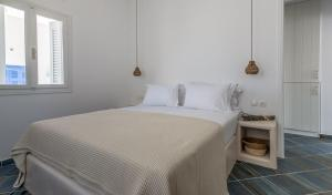 A bed or beds in a room at Michalakis Seaside Suites
