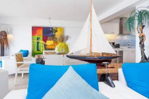A bed or beds in a room at 3 Bedroom Beach Front Villa - on Beautiful Bangrak Beach