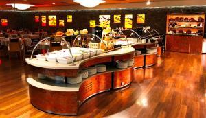 Restaurant ou autre lieu de restauration dans l'établissement Novotel Andorra