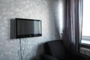 A television and/or entertainment center at Central View Apartament