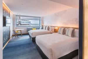 A bed or beds in a room at M Social Auckland