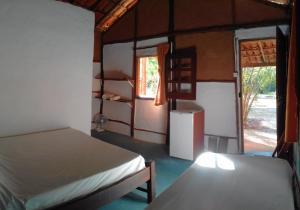 A bed or beds in a room at Pousada Aldeia de Morere