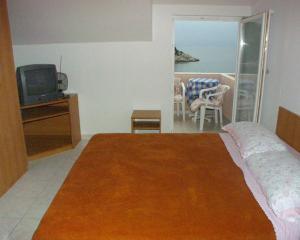 Posteľ alebo postele v izbe v ubytovaní Apartments by the sea Zaklopatica, Lastovo - 995