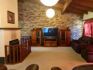 A television and/or entertainment center at Beulah by the Lake