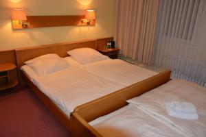 Ein Bett oder Betten in einem Zimmer der Unterkunft Hotel Meyn