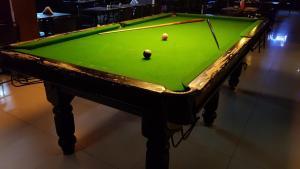 A billiards table at Komfort Terraces Bangalore