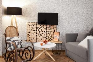 Telewizja i/lub zestaw kina domowego w obiekcie Miód Malvina Apartamenty
