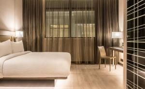 A bed or beds in a room at AC Hotels by Marriott Guatemala City