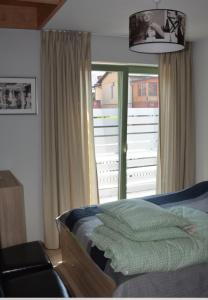 Łóżko lub łóżka w pokoju w obiekcie Green House