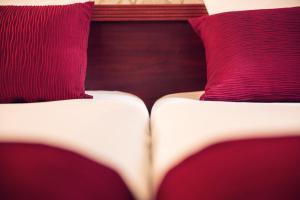 A bed or beds in a room at Timhotel Paris Gare de Lyon