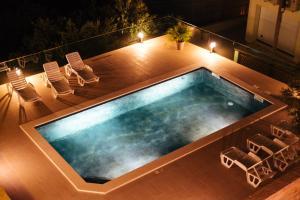 The swimming pool at or near Apartments Martina