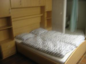 Een bed of bedden in een kamer bij Acacia 2/7