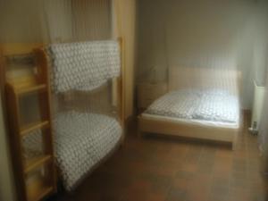 Een stapelbed of stapelbedden in een kamer bij Acacia 2/7