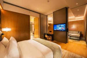 A bed or beds in a room at Mgm Cotai
