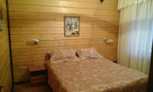 Кровать или кровати в номере Апартаменты в Комплексе Белые Росы