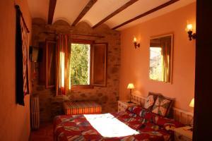 Cama o camas de una habitación en Casa Rural Uyarra
